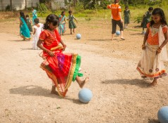 Girls in India play with One World Futbols provided through Communities Rising.