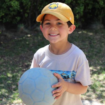 2-boy-smiling-blue-soccer-ball
