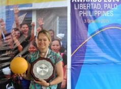 Rachel Haig, Asia Director for One World Play Project, accepted the AFC Dream Asia Award 2014: Corporate on behalf of One World Play Project.
